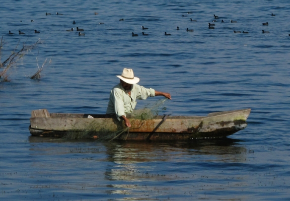 Fishermen use traditional methods to make their catch.