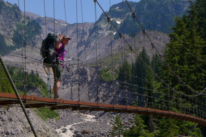 Crossing the Tahoma Creek Suspension Bridge